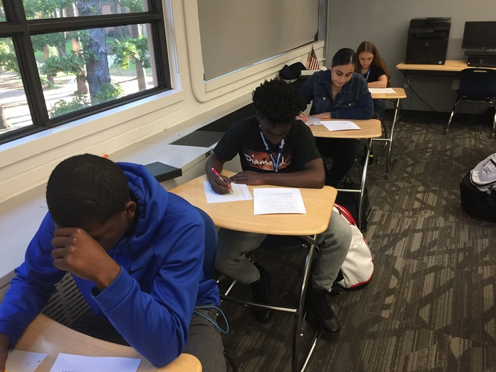 Khari Withers, Michael Hill Jr., Paulina Casillas, and Lauren Davis focusing intently on their World History exam.